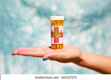 A medical marijuana prescription with a label held by an unknown woman with blue finger nails against a blue sky canvas background