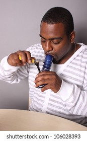 Medical marijuana user with a water pipe.