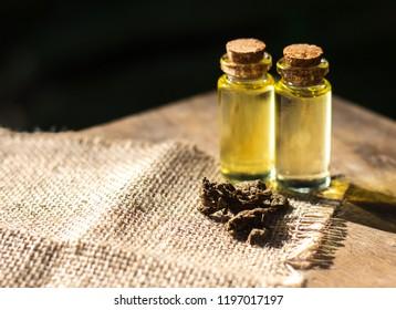 Medical Marijuana,detail of Bottle with CBD oil on wood background, Cannabis Oil - medical marijuana concept