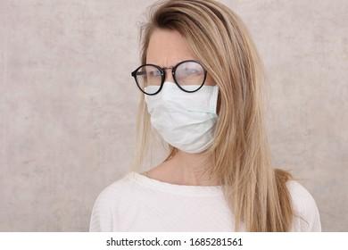 Medical mask and Glasses fogging. Coronavirus prevention, Protection. New habits during Self-isolation , Quarantine