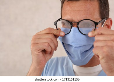 Medical mask and Glasses fogging. Coronavirus prevention, Protection. Male doctor portrait close up