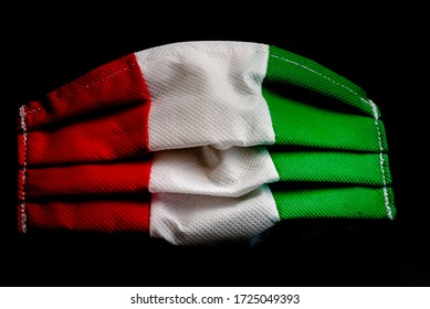 Medical mask with the Italian tricolor on a black background. Close up