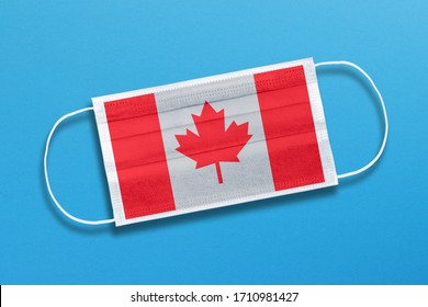 Medical mask, surgical face mask with canada flag on blue background