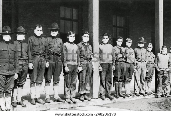 Medical men wore masks to avoid the flu at U.S. Army hospital. Nov. 19, 1918. Army Hospital No. 4. Fort Porter, N.Y. during the 1918-19 'Spanish' Influenza pandemic.