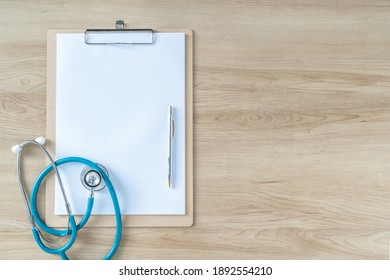 Medical notepad clipboard background with blank note pad paper for patient health record exam or diagnosis on doctor work desk for healthcare copy space