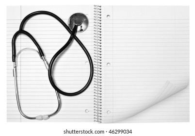 a medical object on the empty notebook