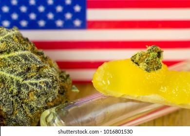 Medical Oil Cannabis - marijuana flower and oil cannabis with USA flag on fresh oak wood background.