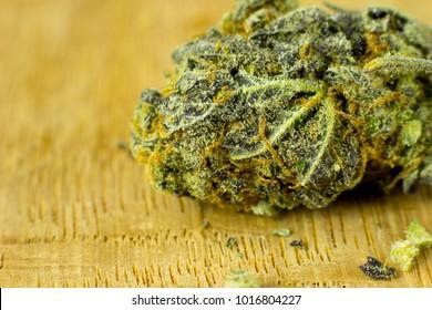 Medical Oil Cannabis - marijuana flower, oil cannabis on the fresh oak wood background.