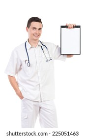 Medical opinion. Smiling male doctor showing a clipboard with blank paper sheet. Three quarter length studio shot isolated on white.