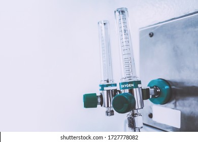 medical oxygen flowmeter tube in the hospital ward to help patients breathing therapy from acute respiratory disease. healthcare and medical background with copyspace.