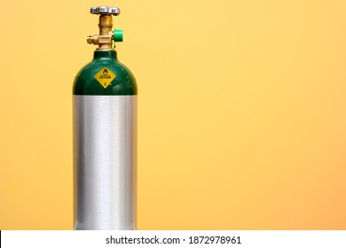 Medical Oxygen Tank Isolated on Yellow Background