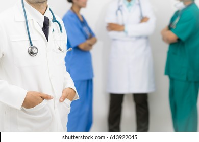 Medical people group including surgeon, nurse and doctors on white background. Selective focus at the front doctor.