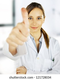 Medical people. Young doctor woman doing OK / woman medical professional at hospital