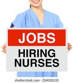 A medical person holding a recruitment sign