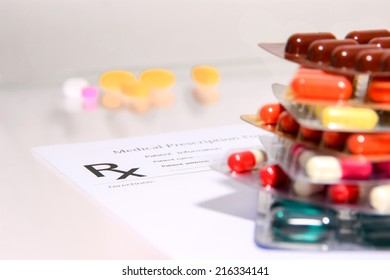 Medical Pharmacist prescription stuff  form - blank prescription and pills on table