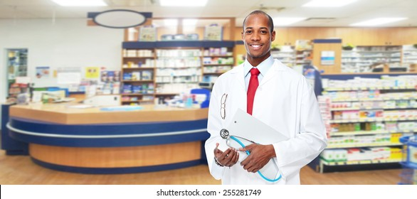 Medical physician doctor man over pharmacy background.
