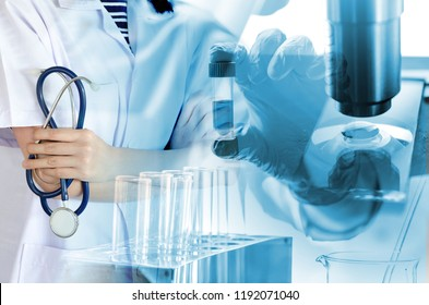 Medical physician doctor woman over laboratory tube blood test and glassware