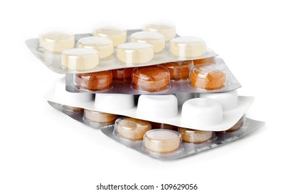 Medical pills in a blisters isolated on white.