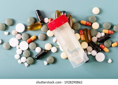 Medical pills and capsules over blue texture background. COVID-19. Top view. Copy space.