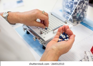 medical pills industry factory and production indoor, worker's hands handling pills
