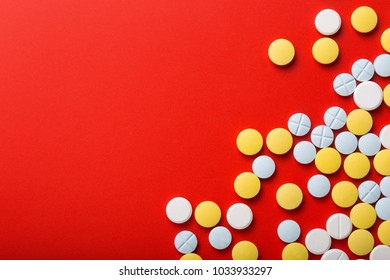 Medical pills . On red background. Top view . Medicine concept