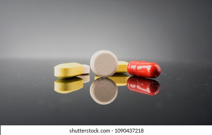 A medical pills with reflection. Health concept