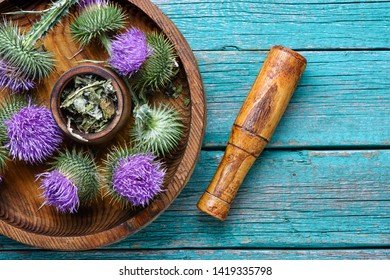 Medical plants flowers.Milk thistle or Silybum marianum.Healing herbs on wooden table