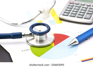 Medical practice financial analysis charts with stethoscope.