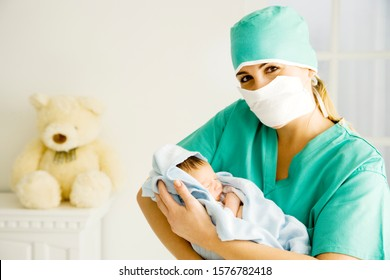 A medical practitioner holding a newborn baby