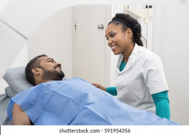 Medical Professional Preparing Man For X-ray Scan In Hospital