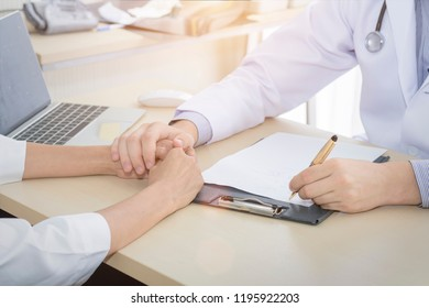 Medical professionals caucasian man reassuring and discussing with young woman worry patient.Close up and copy space.