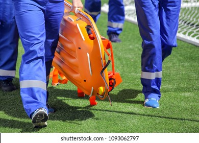 medical professionals with stretchers outdoors