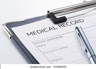 Medical record and pen on white background. Result of medical. Concept image of medical examination.