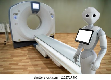 Medical robot on the background of a computer tomograph