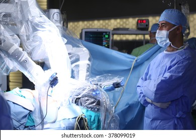 Medical robot. Medical operation involving robot. Robotic Surgery. Manipulators performing surgery on a man - Stock Image