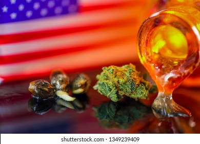 Medical Seeds and Oil  Cannanis - Germinating Seeds with Oil Cannabis CBD THC on the mirroring black background with American Flag, macro view.