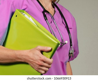 Medical staff carries important patient information in a binder