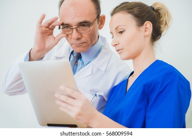 Medical Staff in Hospital. Caucasian Male Doctor and Practitioner Physician Consulting Current Medical Diagnose One of They Patient.
