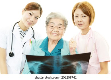 Medical staff with senior woman