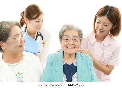 Medical staff with senior women