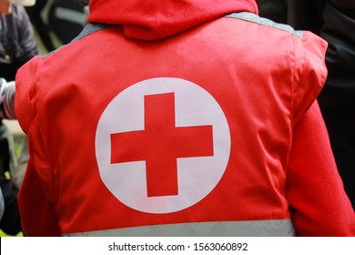 Medical staff in uniform with Red Cross  sing provides medical care at mass event.  Red Cross Volunteer helps people, emergency treatment, coronavirus epidemic, pandemic. Dnipro Ukraine. 9 05 2019