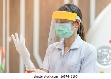 Medical staff wearing face shield, medical mask and medical grove for protect coronavirus covid-19 virus in CT scan room, protective Epidemic virus outbreak concept