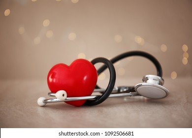Medical stethoscope with heart on grey background. Health care concept