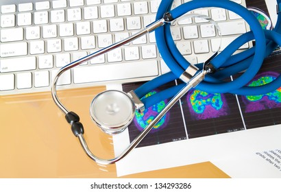 medical stethoscope, keyboard and x-ray on the desktop doctor