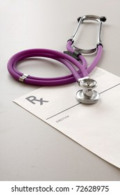 A medical stethoscope on a document