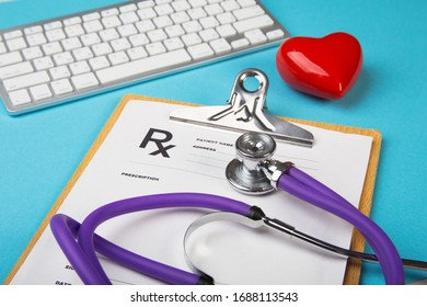 Medical stethoscope and red heart lying on cardiogram chart closeup. Medical help, prophylaxis, disease prevention or insurance concept. Cardiology care.