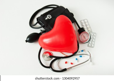 Medical stethoscope with red вalloon heart on white background. Medical concept. February National Heart Month