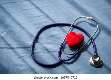 Medical stethoscope and red heart on Patient's bed.Concept healthcare.
