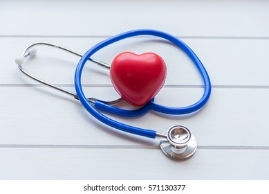Medical stethoscope and red heart on white wooden background,Healthcare and medical concept