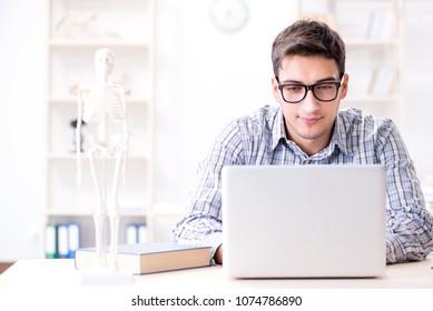 Medical student studing the skeleton